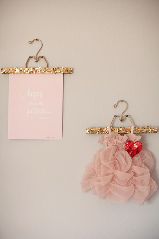 kids dress wall display with print and sparkle hanger on to baby