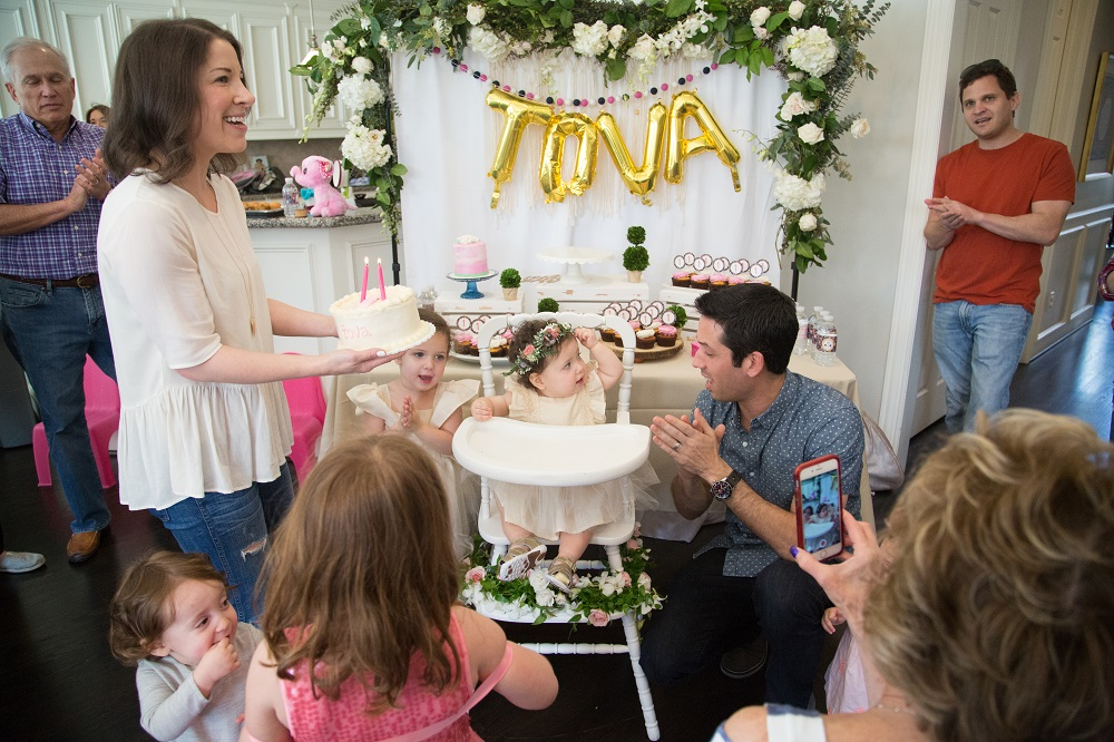 Tova's first birthday party cake smash with floral backdrop