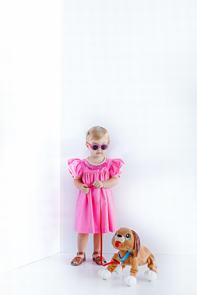 Caitlin dress | bright pink cotton dress with light pink and bright pink pom pom trim sleeves