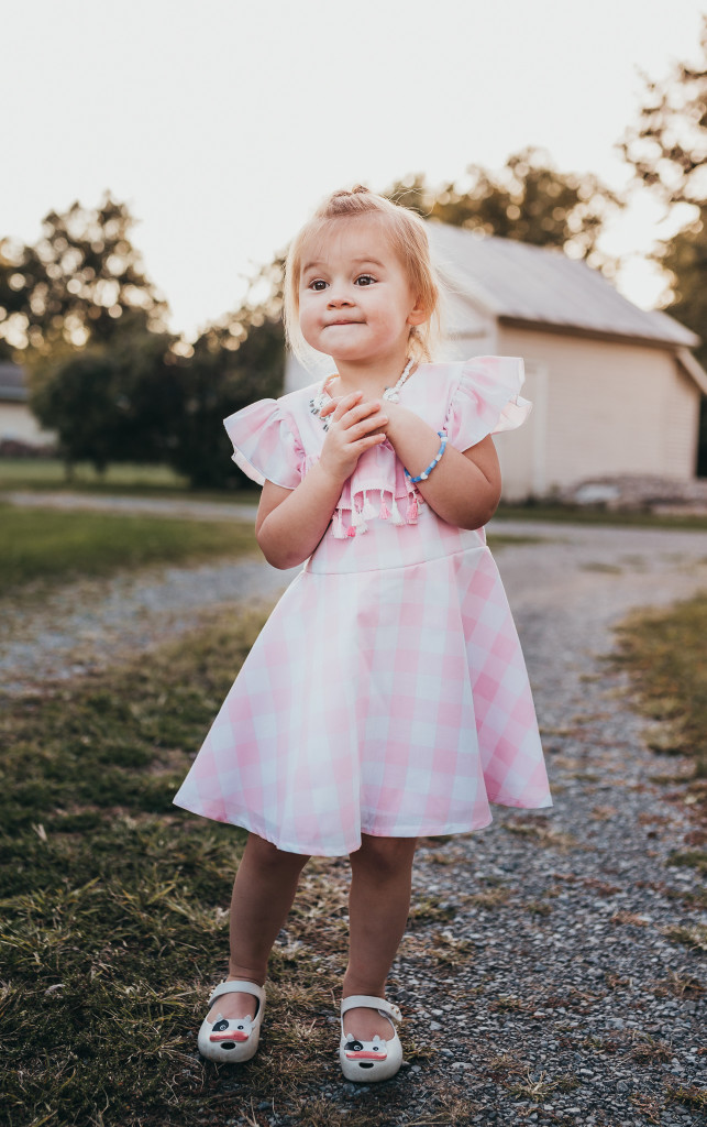 Pink and white buffalo plaid dress for girls. Only available at cuteheads.com.
